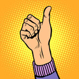 Thumb up gesture like. Pop art retro style. Hand gesture is all right. Hitchhiking gesture. Like in social networks Royalty Free Stock Image