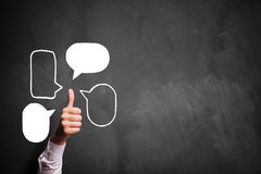 Thumb up gesture with speech bubble symbols Royalty Free Stock Image