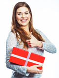 Thumb up girl portrait.Woman hold gift box.  white back Royalty Free Stock Photos