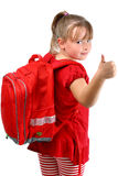Thumb up girl with red schoolbag isolated on white Royalty Free Stock Images