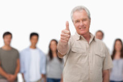 Thumb up given by mature man Stock Images