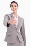 Thumb up given by smiling businesswoman Royalty Free Stock Photo