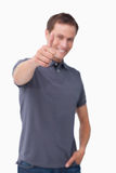Thumb up given by smiling young man Royalty Free Stock Image