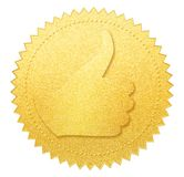 Thumb up gold paper seal or medal isolated. On white Royalty Free Stock Images