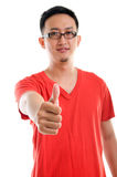 Thumb up good looking young Southeast Asian male. Thumb up good looking young Southeast Asian man isolated over white background Royalty Free Stock Photos