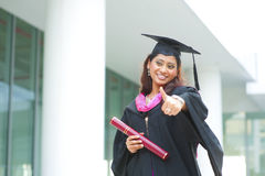 Thumb up graduate Stock Photo