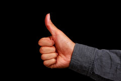 Thumb Up. Hand with black background Royalty Free Stock Photography