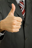 Thumb up. Hand going thumb up, business man detail royalty free stock photography