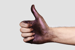 Thumb up Hand with purple Makeup Paint Stock Photos