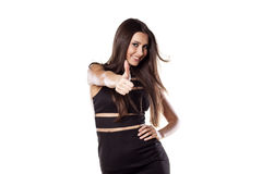 Thumb up. Happy pretty girl showing thumb up on a white background royalty free stock photos
