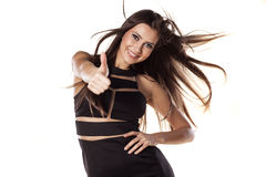 Thumb up. Happy pretty girl with windy hair showing thumb up on a white background stock images