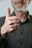 Thumb up. Happy satisfied senior aged man showing thumb up Royalty Free Stock Image