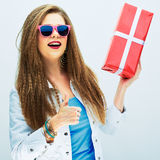 Thumb up. happy smiling woman hold red gift Stock Images