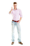 Thumb up!. Happy young man isolated on white Stock Photography