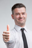 Thumb up for happy young man Royalty Free Stock Photos