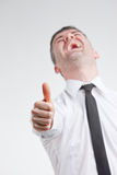 Thumb up for happy young man Stock Image