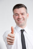 Thumb up for happy young man royalty free stock photo
