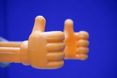 Thumb up. Icon of thumb up in blue background Stock Photos