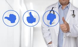 Thumb up icon concept and doctor with thumbs up stock photo