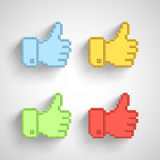 Thumb up icon in pixel art. Royalty Free Stock Photography