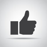 Thumb up icon with shadow on a gray background. Vector illustration vector illustration