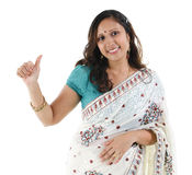 Thumb up Indian woman. Beautiful Indian woman showing thumb up hand sign on white background Royalty Free Stock Photos