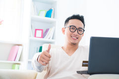 Thumb up internet shopping Stock Photo