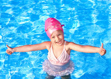 Thumb up of kid in swimming pool. Stock Photography
