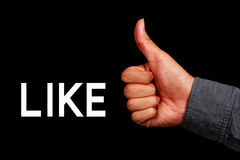 Thumb Up Like. Thumb up hand with black background Royalty Free Stock Photo