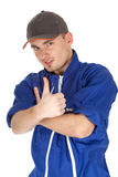 Thumb up man in blue coveralls and baseball cap Royalty Free Stock Photos