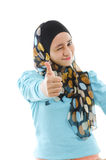 Thumb up Muslim woman. Cute young Muslim girl giving a thumb up sign over white background Royalty Free Stock Photography