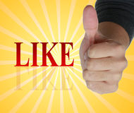 Thumb up next to like Royalty Free Stock Image