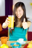 Thumb up for orange juice Royalty Free Stock Images