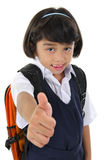 Thumb up primary school girl Stock Images