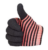 Thumb up showing by hand with black and red knitting wool glove. Isolated on white background Royalty Free Stock Photo