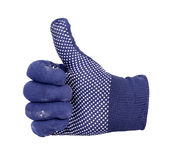 Thumb up showing by hand with blue and white dot knitting wool g Stock Photos
