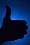 Thumb up silhouette with bluish background Royalty Free Stock Photo