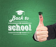 thumb up with the sketch of the graduation hat Stock Photography