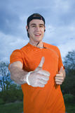 Thumb up and smiling runner Stock Image