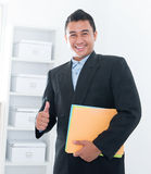 Thumb up Southeast Asian executive Royalty Free Stock Photo