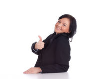 Thumb up, successful businesswoman Stock Images