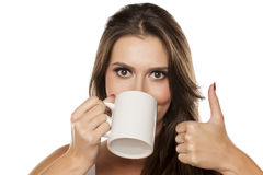 Thumb up for the tea Royalty Free Stock Photography
