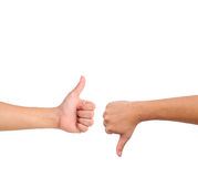 Thumb up and thumb down hand signs Royalty Free Stock Images