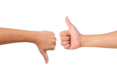 Thumb up and thumb down hand signs Royalty Free Stock Photography