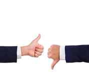 Thumb up and thumb down hand signs Stock Images