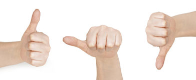 Thumb up and thumb down hand signs. On white Royalty Free Stock Image