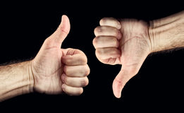 Thumb up and thumb down. Thumb down and thumb up for like and dislike or Approval and disapproval concept Stock Photography