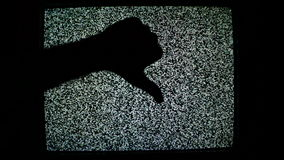 Thumb up and thumb down for like and dislike or Approval and disapproval concept against static TV noise background. stock video