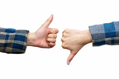 Thumb up and thumb down on white. Thumb up and thumb down hand signs of like and dislike isolated on white background Royalty Free Stock Photography
