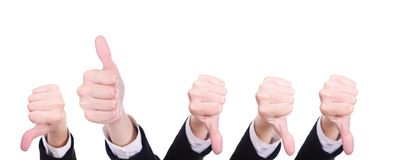 Thumb up and thumbs down. One thumb up and several thumbs down, isolated on white background Stock Photo